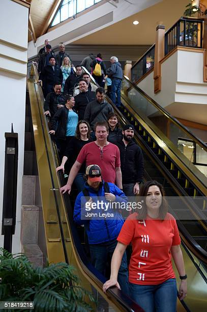 Tesla fans head down the escalator to stand in line in front of the showroom at Park Meadows March 31 2016 to preorder the new Tesla due to be...
