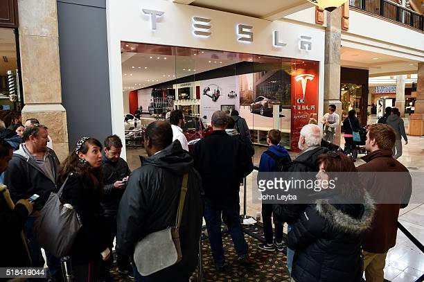 Tesla fans stand in line at Park Meadows March 31 2016 to preorder the new Tesla due to be unveiled Thursday night Some Tesla fans showed up as early...