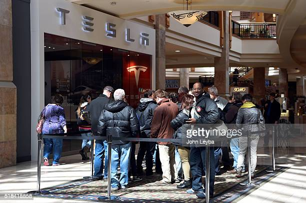 Tesla fans stand in line inside Park Meadows Mall March 31 2016 to preorder the new Tesla due to be unveiled Thursday night Some Tesla fans showed up...