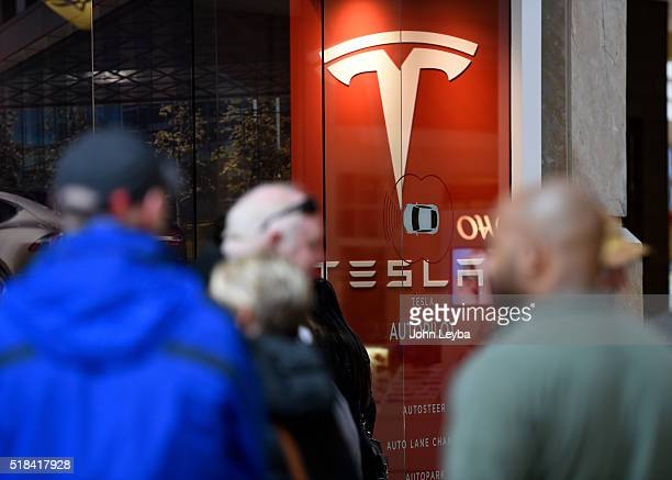 Tesla fans stand in long lines inside Park Meadows March 31 2016 to preorder the new Tesla due to be unveiled Thursday night Some Tesla fans showed...