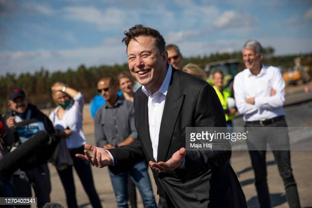 Tesla head Elon Musk talks to the press as he arrives to to have a look at the construction site of the new Tesla Gigafactory near Berlin on...