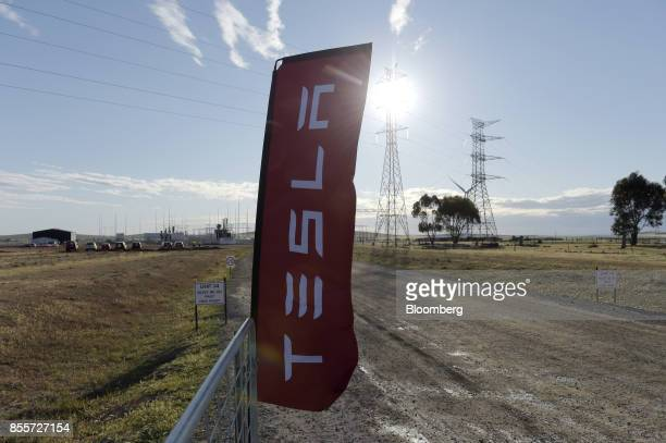 A Tesla Inc banner stands ahead of an event at the entrance to the Hornsdale wind farm operated by Neoen SAS near Jamestown South Australia on Friday...