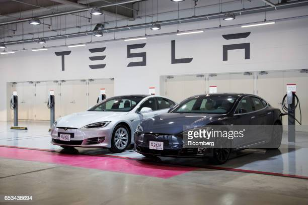 Tesla Inc Model S 90D electric vehicles are parked at the company's charging station in the Starfield Hanam shopping complex operated by Shinsegae Co...