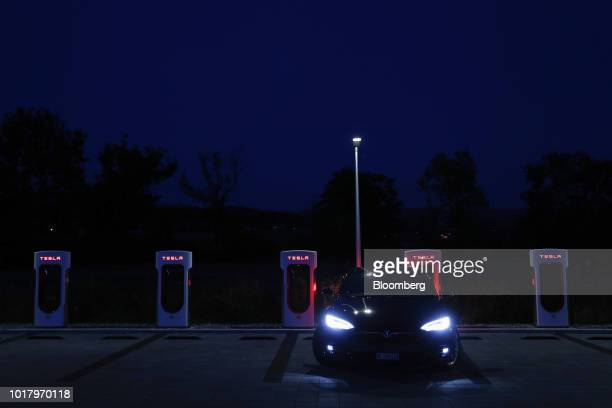 A Tesla Inc Model S electric vehicle charges at a Supercharger station at night in Rubigen Switzerland on Thursday Aug 16 2018 Tesla chief executive...