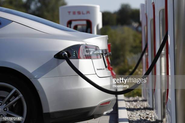 A Tesla Inc Model S electric vehicle charges at a Supercharger station in Rubigen Switzerland on Thursday Aug 16 2018 Tesla chief executive officer...