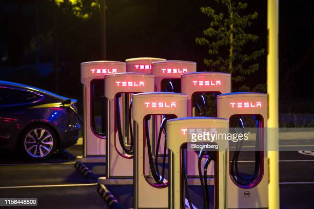 A Tesla Inc Model S electric vehicle charges at an illuminated Supercharger station at night in Sant Cugat Spain on Wednesday July 10 2019 Tesla is...