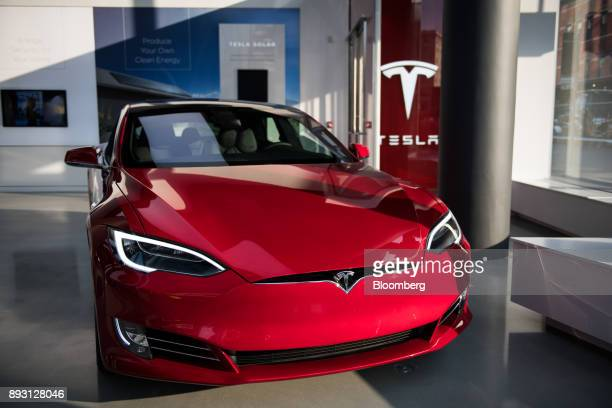 A Tesla Inc Model S P100D sedan vehicle sits on display at the company's new showroom in New York US on Thursday Dec 14 2017 The Meatpacking District...