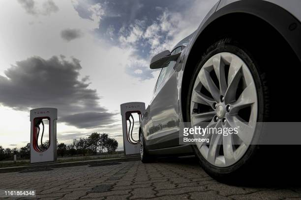 A Tesla Inc Model X electric automobile sits parked at a supercharger in Nempitz near Leipzig Germany on Thursday Aug 15 2019 In Europe Tesla is...