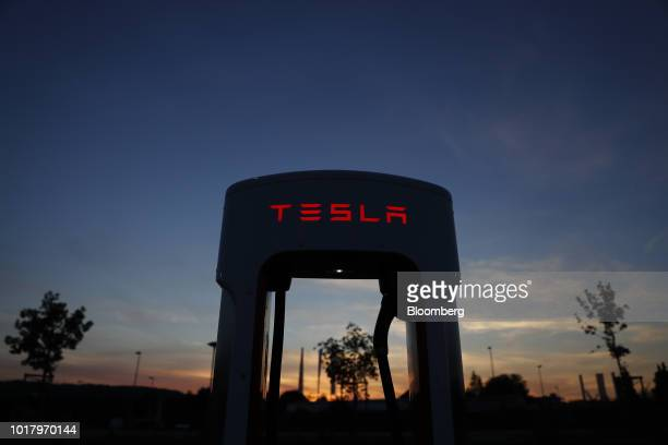 A company logo hangs outside a Tesla Inc store in Bern Switzerland on Thursday Aug 16 2018 Tesla chief executive officer Elon Musk has captivated the...