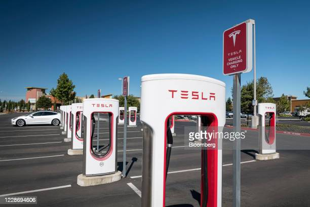 A Tesla Inc vehicle charging at a Tesla Supercharger station in Petaluma California US on Thursday Sept 24 2020 California will phase out sales of...