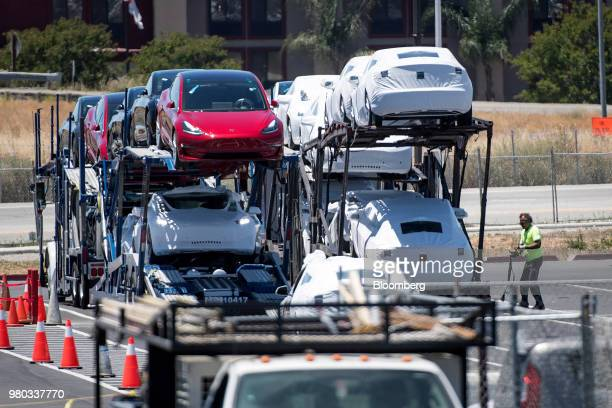 Tesla Inc vehicles are loaded onto a truck for transport at the company's manufacturing facility in Fremont California US on Wednesday June 20 2018...