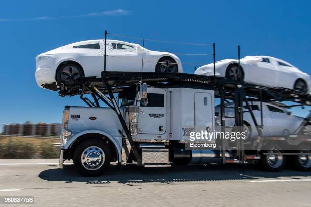Tesla Inc vehicles are transported on a truck after leaving the company's manufacturing facility in Fremont California US on Wednesday June 20 2018...