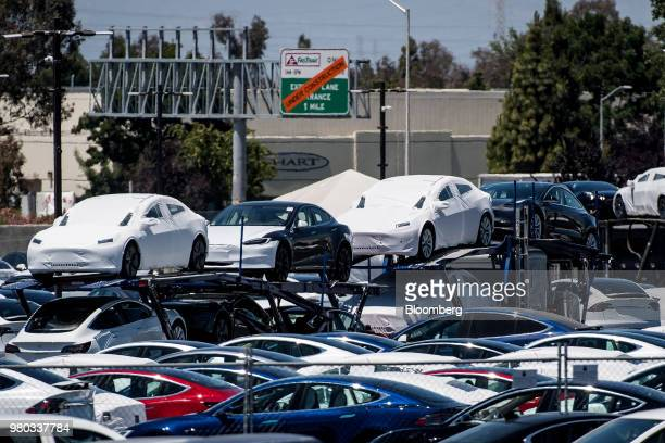 Tesla Inc vehicles sit on a truck for transport at the company's manufacturing facility in Fremont California US on Wednesday June 20 2018 Tesla CEO...