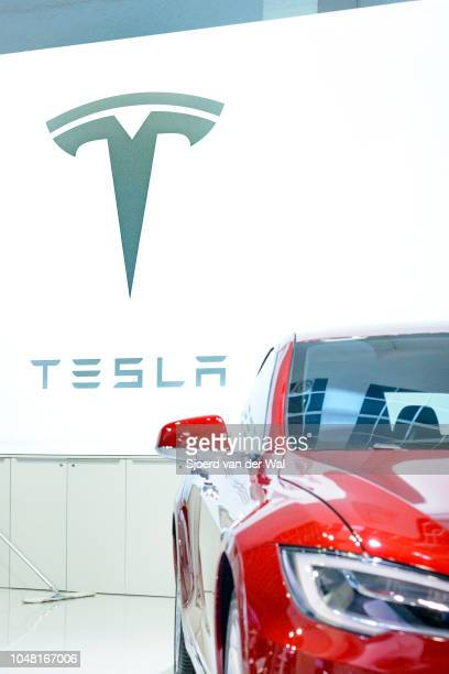 Tesla logo and name on the wall of the Tesla stand behind a Tesla Model S 75D allelectric luxury saloon car on display at Brussels Expo on January 13...