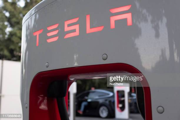 Tesla logo is seen on a charging station in Mountain View, California, United States on October 3, 2019. Telsa Inc. Shares fell more than 4 percent...