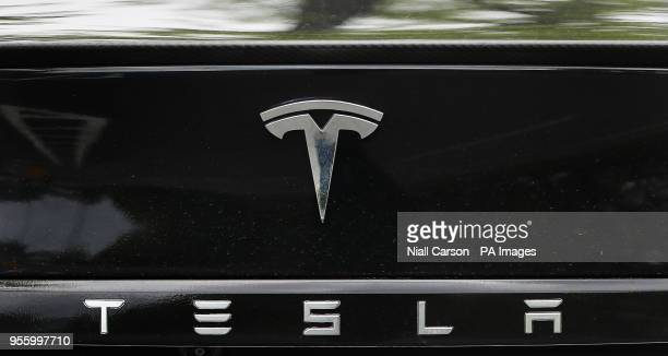 A Tesla logo on a Tesla Model S car at a launch event for the MobilityX selfdriving conference a gathering of global autonomous vehicle leaders in...