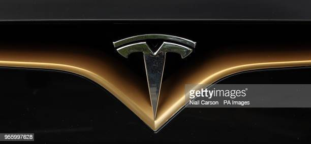 A Tesla logo on the front of a Tesla Model S car at a launch event for the MobilityX selfdriving conference a gathering of global autonomous vehicle...