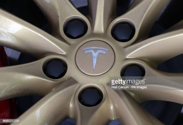 A Tesla logo on the wheel of a Tesla Model S car at a launch event for the MobilityX selfdriving conference a gathering of global autonomous vehicle...