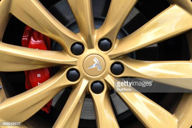 A Tesla logo on the wheel of a Tesla Model S P100D car at a launch event for the MobilityX selfdriving conference On Tuesday May 8 in Dublin Ireland