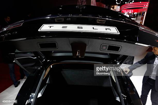 A Tesla logo sits on the truck door of a Tesla Model S automobile produced by Tesla Motors Inc at the Paris Motor Show on the final preview day in...
