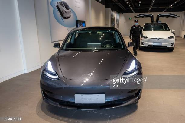 Tesla Model 3 car and a Tesla Model X vehicle are seen at the first Tesla Center in Shanghai on May 9 2020 in Shanghai China