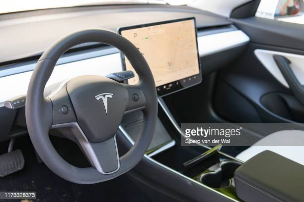 Tesla Model 3 compact full electric car interior with a large touch screen on the dahsboard on display at the 2019 Concours d'Elegance at palace...