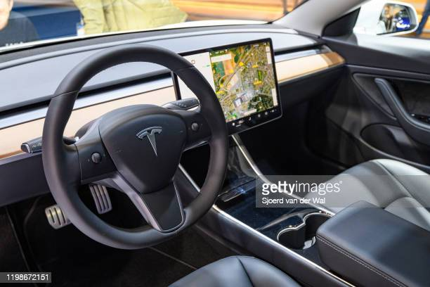 Tesla Model 3 compact full electric car interior with a large touch screen on the dashboard on display at Brussels Expo on JANUARY 09 2020 in...