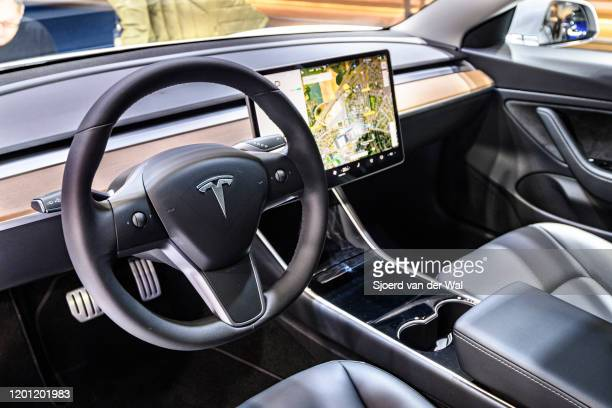 Tesla Model 3 compact full electric car interior with a large touch screen on the dashboard on display at Brussels Expo on January 9 2020 in Brussels...