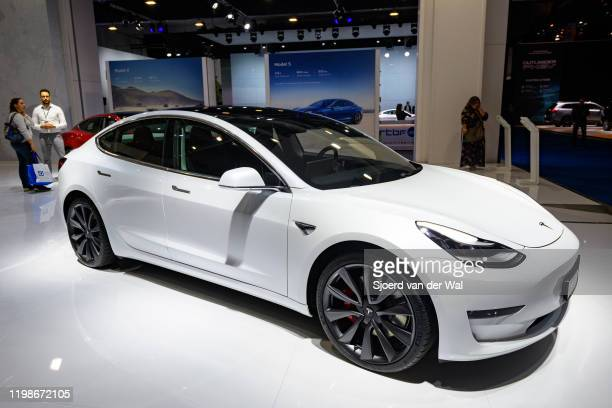 Tesla Model 3 compact sedan car in white on display at Brussels Expo on JANUARY 09 2020 in Brussels Belgium The Model 3 is fitted with a full...