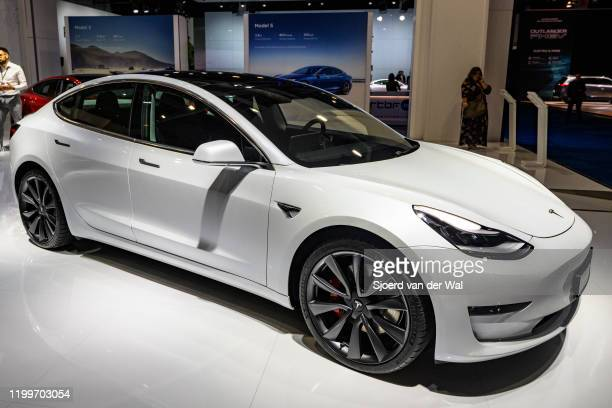 Tesla Model 3 compact sedan car in white on display at Brussels Expo on January 9 2020 in Brussels Belgium The Model 3 is fitted with a full...