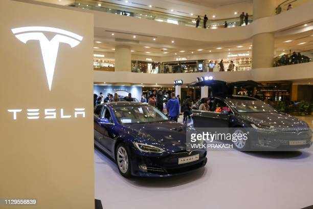 A Tesla Model S and Model X are displayed at a shopping mall in Hong Kong on March 10 2019 Electric carmaker Tesla has won more than 520 million USD...