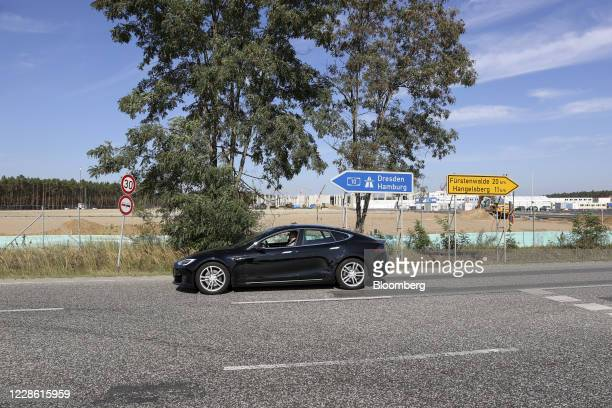 Tesla Model S automobile passes outside the Tesla Inc. Gigafactory site in Gruenheide, Germany, on Sunday, Sept. 20, 2020. The plant that underpins...