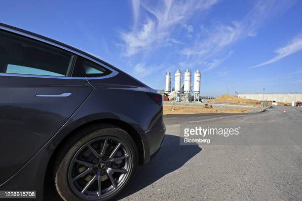 Tesla Model S automobile sits outside the Tesla Inc. Gigafactory site in Gruenheide, Germany, on Sunday, Sept. 20, 2020. The plant that underpins its...