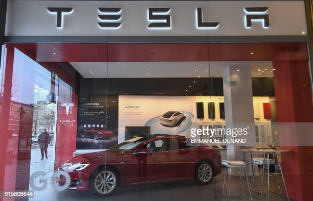 A Tesla Model S car by US car maker Tesla is displayed at a store in Brussels on February 8 2018 A day after launching one of its cars into space...