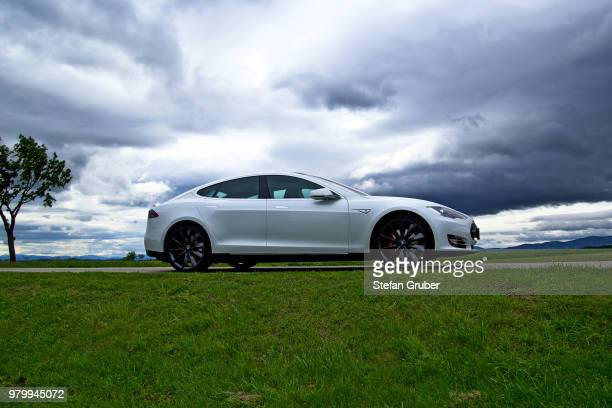 tesla model s & clouds - tesla model s stock photos and pictures