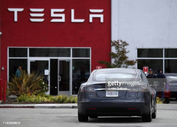 Tesla Model S drives into the parking lot of a Tesla showroom and service center on May 20 2019 in Burlingame California Stock for electric car maker...
