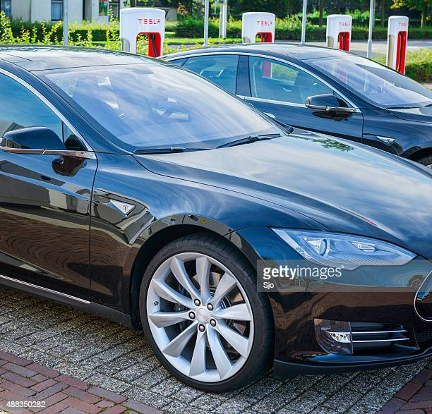 tesla model s electric car at a supercharger charging station - letter s stock pictures, royalty-free photos & images