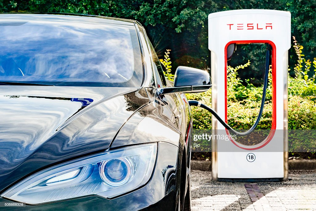 Tesla Model S electric car at a supercharger charging station : Stock Photo