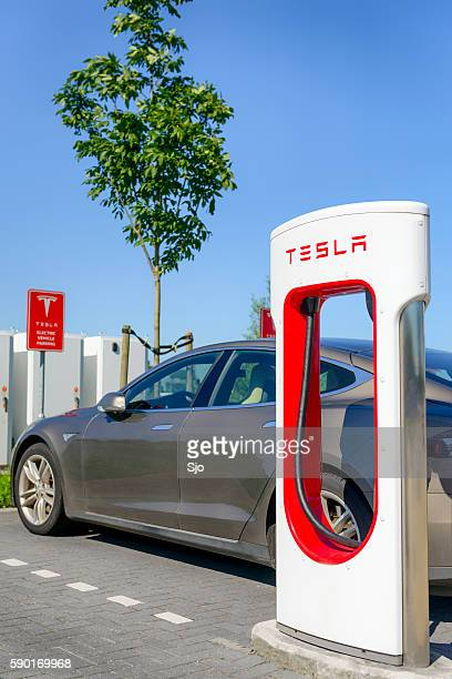 tesla model s electric car at a supercharger charging station - supercharged engine stock pictures, royalty-free photos & images