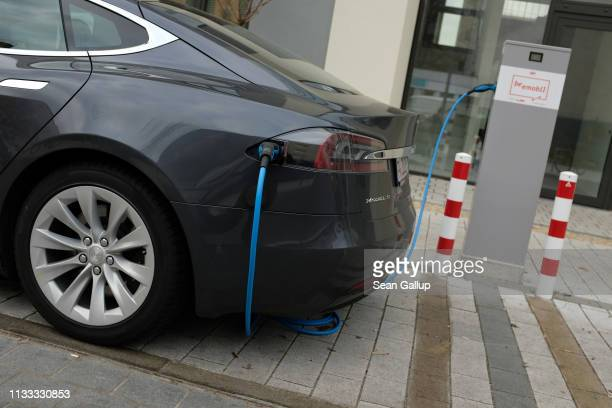Tesla Model S electric car charges at a public charging column on March 2, 2019 in Berlin, Germany. Tesla recently announced it is closing many of...