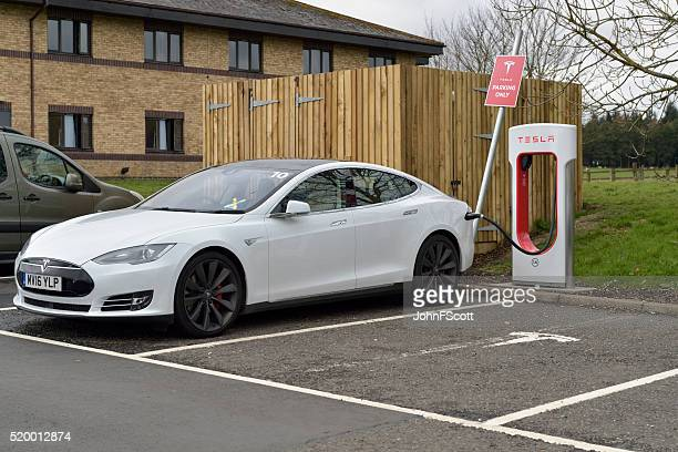 Tesla model S electric car parked at a charging station