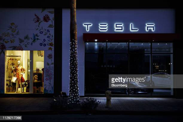 Tesla Model S electric vehicle sits inside of a closed Tesla Inc. Store in Palm Desert, California, U.S., on Thursday, March 7, 2019. Tesla has cut...