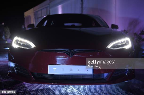 A Tesla Model S electric vehicle sits on display during a Tesla Inc event at the Hornsdale wind farm operated by Neoen SAS near Jamestown South...