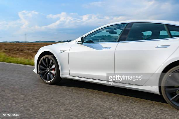 Tesla Model S full electric luxury car driving