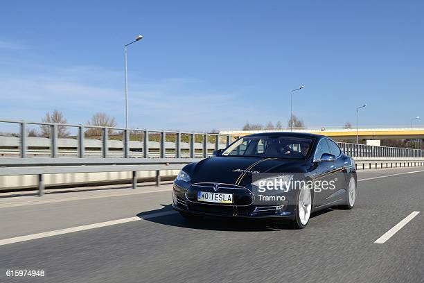tesla model s in motion - tesla model s stock photos and pictures