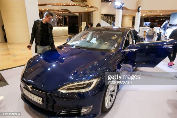 A Tesla Model S is displayed at a shopping mall in Hong Kong on March 10 2019 Electric carmaker Tesla has won more than 520 million USD in loans from...