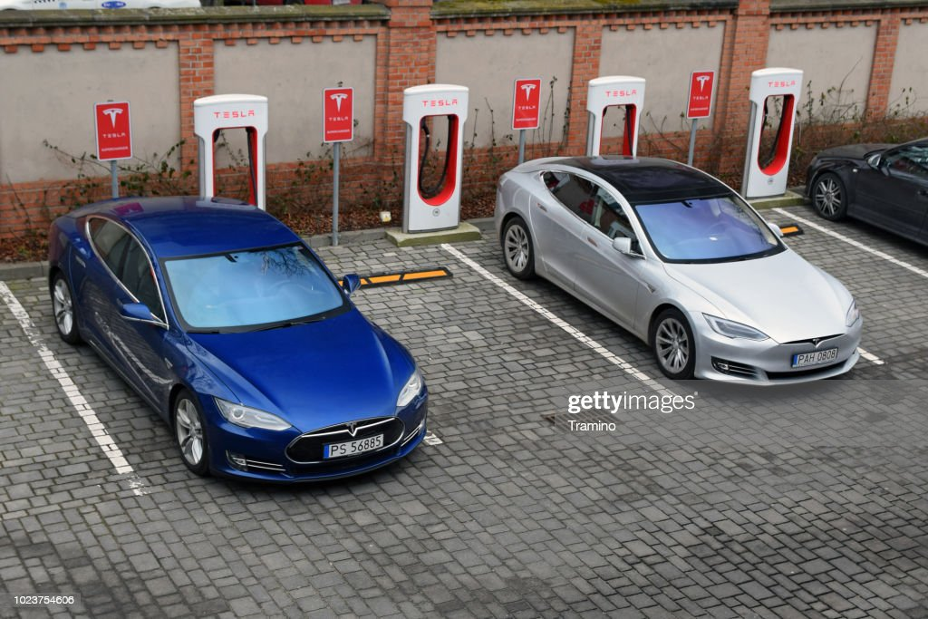Tesla Model S vehicles on the electric charging point : Stock Photo