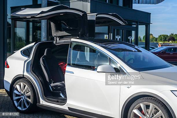 Tesla Model X crossover SUV with open falcon wing doors