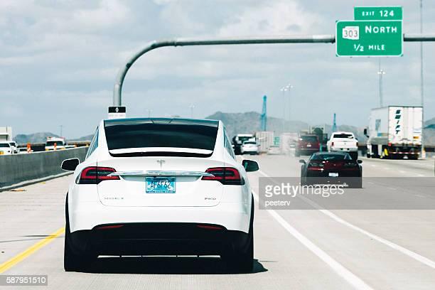 Tesla Model X on the road in Arizona.