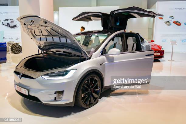 Tesla Model X P90D full electric luxury crossover SUV car front view. The rear Falcon Wing doors are open. The Model X P90D is the highest...